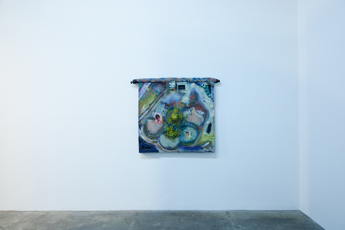 A Constantly Nagging Slight Breeze, 2012. Acrylic, fabric, rice, powdered pigment, wood, wicker. 48 x 40 x 5 ½ inches.